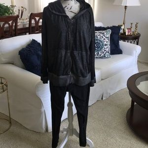 Two piece hooded jogging or exercise suit.